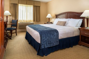 Standard Rooms Feature Comfortable King Bed Cable Tv Wireless Internet Walkways And Bathrooms
